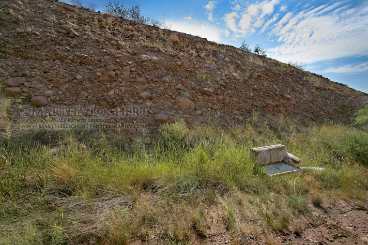 Discarded couch on a hill in southern Arizona, near Rio Rico, photographed by Tucson photographer Martha Lochert.