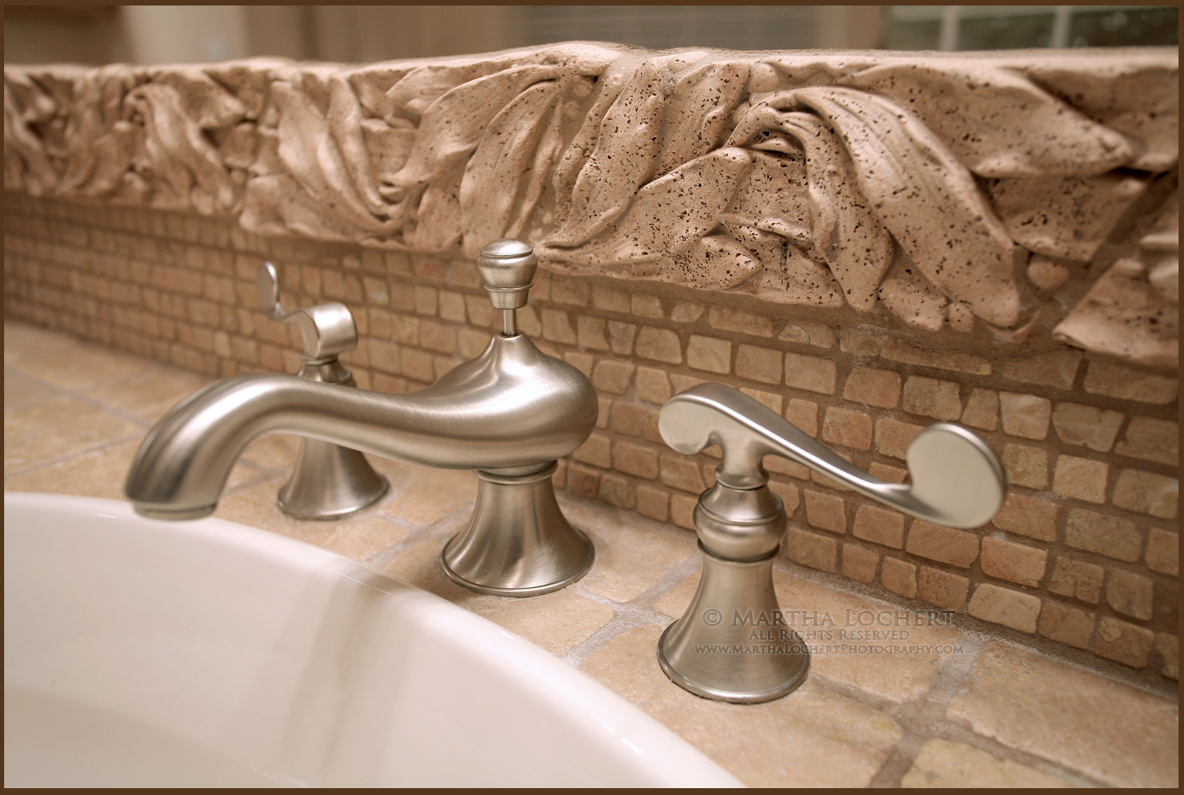 Bathroom faucet as a visual for the importance of washing hands thoroughly and often